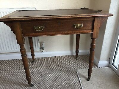 Oak Victorian writing desk table leather top and castors, 1 drawer, needs tlc