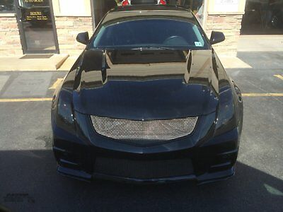 2011 Cadillac CTS custom 2011 Cadillac CTS V Black on Black, Shaved and Tuned- supercharged