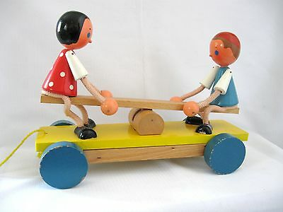 VINTAGE  CZECHOSLOVAKIAN WOODEN PULL TOY..BOY / GIRLon SEE SAW...