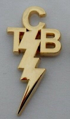 Elvis Presley Taking Care of Business TCB gilt / gold coloured pin badge.
