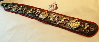 *an Eye Catching Leather Strap Of Eleven Brass Horse Charms*