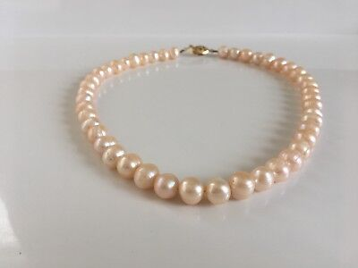 "Cream, South sea, Barque pearl necklace. 7-8MM, 59 pearls, 17"" strand"