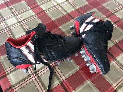 Boys Patrick used rugby boots, size C13. Black, red & white colour scheme.