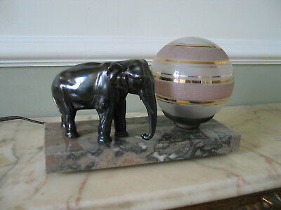 superb original  french art deco lamp with an spelter elephant