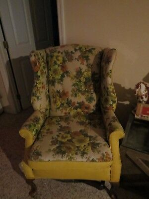 Vintage 1960s wing-back chair. yellow and green flower pattern.