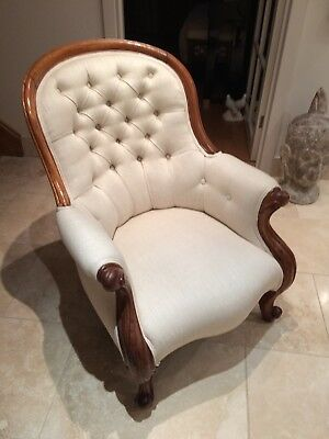 Two matching Victorian button-back upholstered, spoon-back chairs