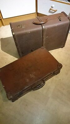 Vintage very old and tatty suitcases props