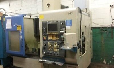 4 Axis Hitachi Seiki Model #VM40lll CNC Vertical Machining Center