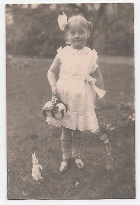 Little girl with Easter Eggs and Rabbit photo postcard