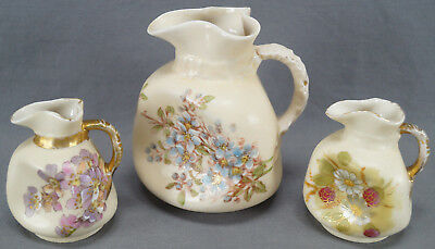 Set of 3 Schmidt & Co Pinched Shape Hand Painted Floral Pitchers C. 1891 - 1918