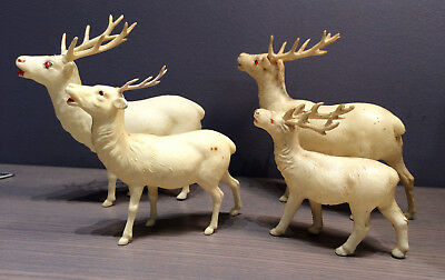 4 Vintage Celluloid reindeer Three have red jeweled eyes Christmas ornaments
