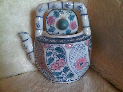 Tea pot novilty like a watering can with flowers on side