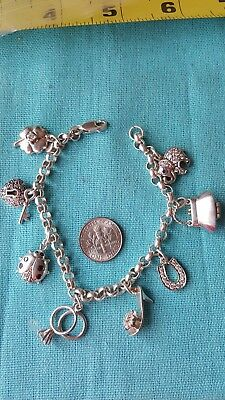 "Sterling charm bracelet with charms 7.5"" long"