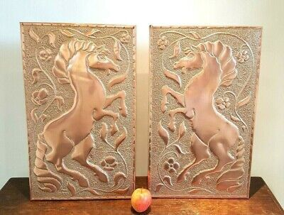 Pair Arts & Crafts style copper plaques depicting horses, rearing horses, equine