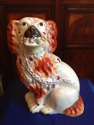 ROBUSTLY POTTED 19thC STAFFORDSHIRE SPANIEL BASKET FLOWERS IN MOUTH c1860-70