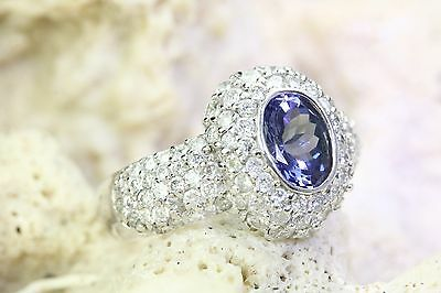 14K White Gold AAA Oval Cut Tanzanite and White Round Diamond Ring 2.32 Carats