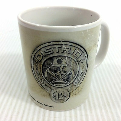 The Hunger Games Coffee Mug District 12 May The Odds Be Ever In Your Favor