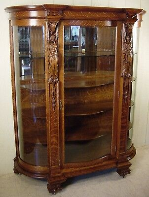 Antique Oak Curved Glass China Cabinet with Carved Women & Ram's Heads
