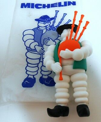 Michelin Man Bibendum Playing Bagpipes With Original Bag