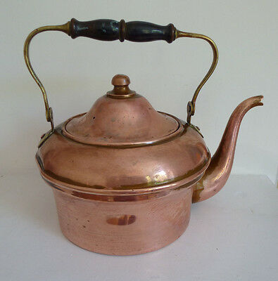 A pretty French vintage copper kettle with wood and brass handle