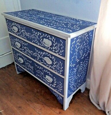 Bepoke vintage chest of solid wooden drawers with hand painted leaves.