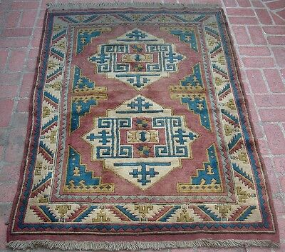 A Decorative Caucasian Style Rug with Soft Wool and Teal Ground