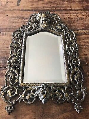 Antique Bacchus Greek Wine God beveled antique brass mirror from late 1800's.