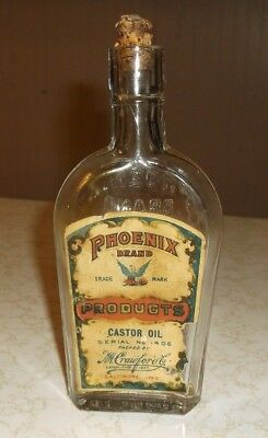 Vintage Phoenix Brand Products Castor Oil bottle with original paper label