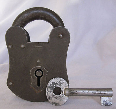 An old Iron padlock lock with key made very strong and heavy decorative shape.