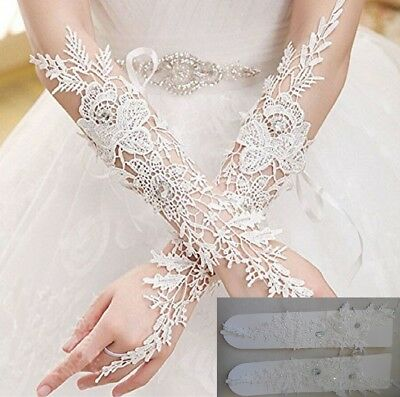 A pair of bridal ivory beaded lace gloves wedding sequined floral lace gloves