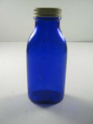 """blue Bottle with lid (has """"M"""" on the bottom)"""
