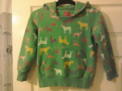 Girls Joules Hooded top. Green with coloured horse designs. Age 7