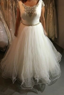 Casablanca sample bridal gown #2167. Size 18, Ivory/diamond Don't miss it. BO