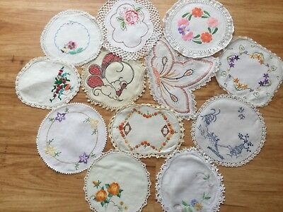 12 small hand embroidered doilies