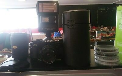 Canon A-1 35mm SLR Film Camera bundlr with 3 lenses, filters. & instructions