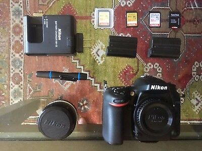 Nikon D7100; 50mm F/1.8 Lens; 2 Batteries; 4 Memory Cards