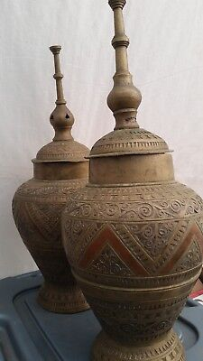 Ancient Asian antique brass ornate urns pair with red accents