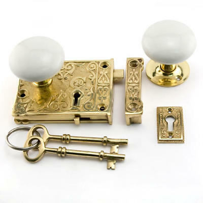 Signature Hardware Ornate Solid Brass Rim Lock Set with Porcelain Knobs