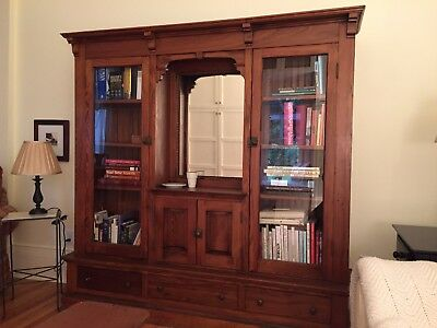 Antique breakfront with beveled mirror & egg-and-dart moulding