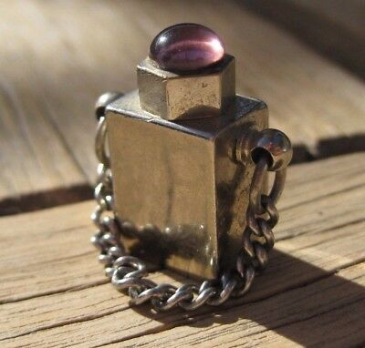 Vintage Heavy Metal PERFUME BOTTLE w/PURPLE GLASS CABOCHON set in top.CHARM or?