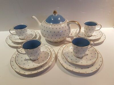 susie cooper blue snowflake teapot and 4 trios (cup, saucer, side plate)