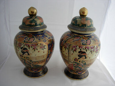 pair of satsuma vaes with covers lids urn shaped