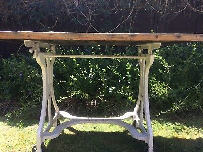Cast iron original mangle stand, with woodentable top