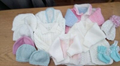 large bundle of new hand knitted baby clothes