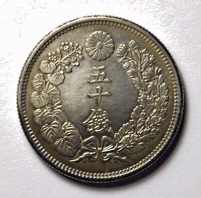 JP Meiji Yr 43 (1910) 50 Sen Silver (adhesive residue in the back)