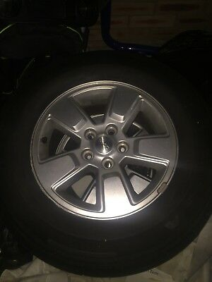 Four Original Jeep Cherokee Wheels with Tire