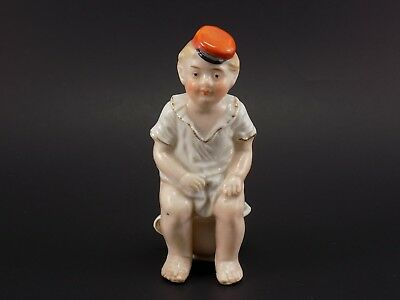 Antique Victorian Porcelain Ceramic Figurine of Boy Sitting on Chamber Pot