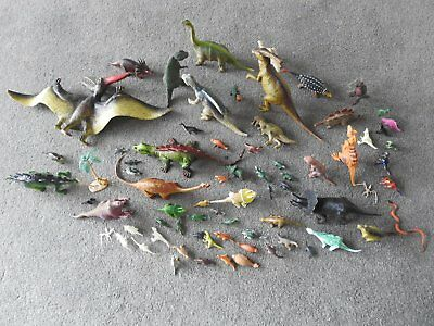 box of toy dinosaurs