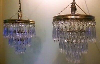 Pair of three tier Italian Art Deco brass chandeliers