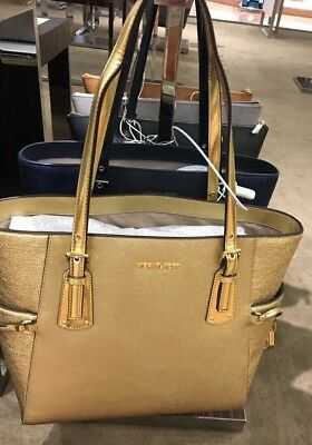 4b47f36e0ac5 NWT MICHAEL KORS Voyager East   West Signature Tote Gold -  199.00 ...